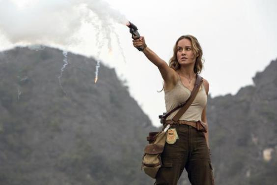 "Photojournalist Mason Weaver (Brie Larson) fires a flare gun in ""Kong: Skull Island."" Warner Bros. Pictures photo"