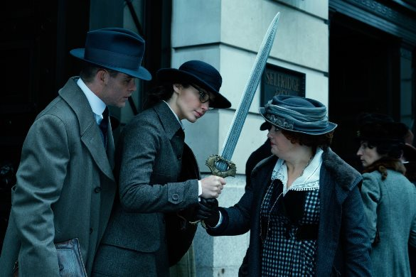 "Wonder Woman (Gal Gadot, center) can't help but notice that there's no place to put her sword in this outfit. From left, Chris Pine, Gadot and Lucy Davis appear in a scene from ""Wonder Woman."" Warner Bros. photo"
