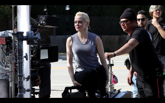 "Rose McGowan, center, appears behind the scenes of her directorial debut, the short film ""Dawn."" Black Dog Films photo"
