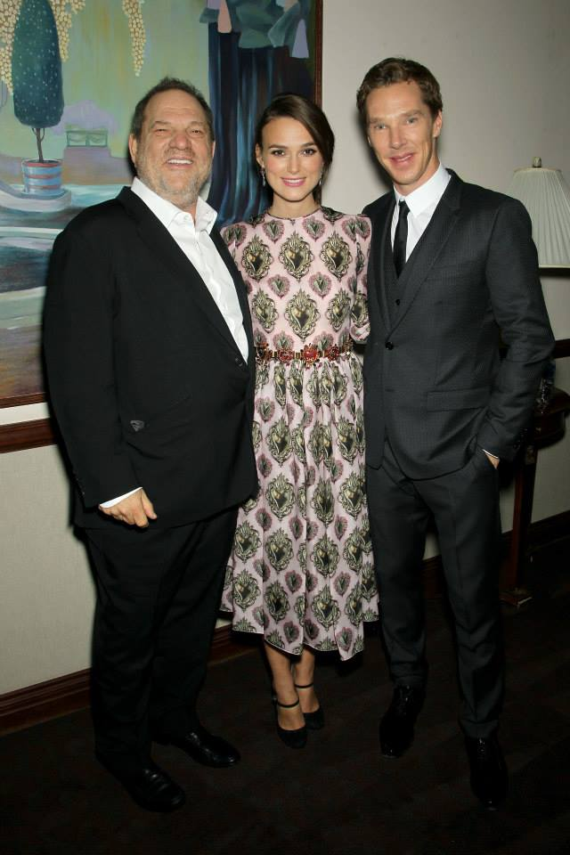"Harvey Weinstein, left, smiles for a photo with ""The Imitation Game"" stars Benedict Cumberbatch and Keira Knightley at the film's 2014 New York premiere. Weinstein was terminated from The Weinstein Company Sunday following a New York Times expose last week that detailed decades of sexual abuse allegations made against the Oscar-winning producer. Photo via The Weinstein Company Facebook"