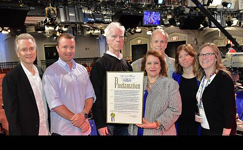 "A proclamation declaring ""Late Show with David Letterman Day"" is presented to the Late Show staff by Commissioner López. Pictured left to right: Jerry Foley, Shawn Walters, Pat Farmer, Commissioner López, Tim Kennedy, Amy Rubin, and Kathy Mavrikakis. Photo courtesy of CBS."