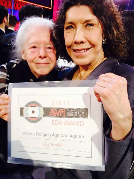 AWFJ President Jennifer Merin presents Lily Tomlin with the AWFJ EDA Award for Actress Defying age and Ageism